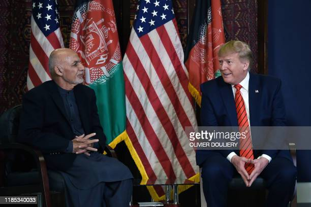 US President Donald Trump holds a bilateral meeting with Afghan's President Ashraf Ghani at Bagram Air Field during a surprise Thanksgiving day visit...