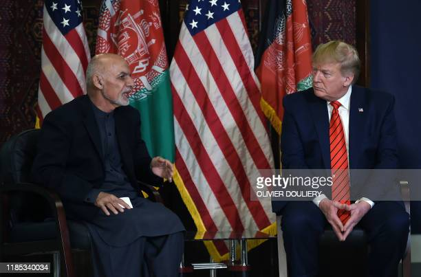 President Donald Trump holds a bilateral meeting with Afghan's President Ashraf Ghani at Bagram Air Field during a surprise Thanksgiving day visit,...