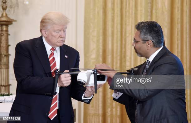 US President Donald Trump holds a drone as George Mathew CEO Chairman of Kespry explains how it work during the American Leadership in Emerging...