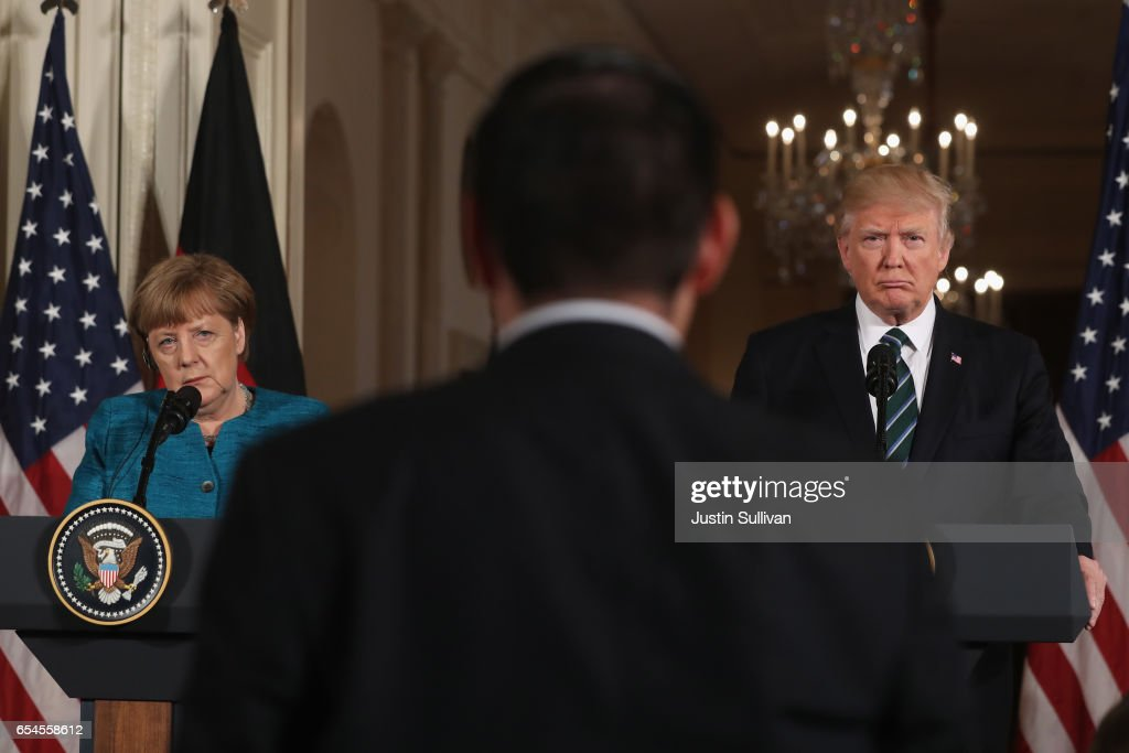 U.S. President Donald Trump (R) holds a joint press conference with German Chancellor Angela Merkel (L) in the East Room of the White House on March 17, 2017 in Washington, DC. The two leaders discussed strengthening NATO, fighting the Islamic State group, the ongoing conflict in Ukraine and held a roundtable discussion with German business leaders during their first face-to-face meeting.