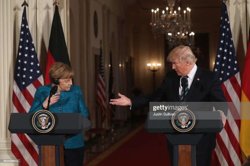 U.S. President Donald Trump (R) holds a joint press conference with German Chancellor Angela Merkel in the East Room of the White House on March 17, 2017 in Washington, DC. The two leaders discussed strengthening NATO, fighting the Islamic State group, the ongoing conflict in Ukraine and held a roundtable discussion with German business leaders during their first face-to-face meeting.