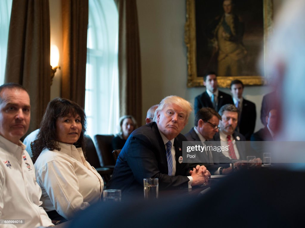 U.S. President Donald Trump holds a listening session on health care with truckers and CEOs from the American Trucking Associations in the Cabinet Room at the White House on March 23, 2017 in Washington, DC.