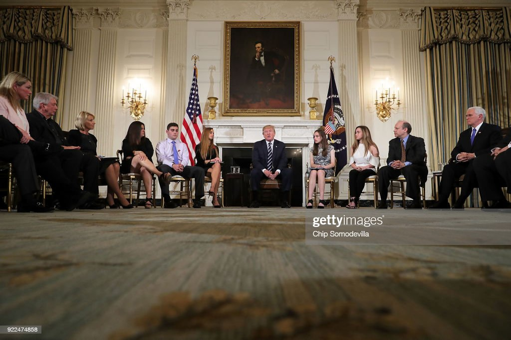 U.S. President Donald Trump (C) holds a listening session with students survivors of mass shootings, their parents and teachers in the State Dining Room at the White House February 21, 2018 in Washington, DC. Trump is hosting the session in the wake of last week's mass shooting at Marjory Stoneman Douglas High School in Parkland, Florida, that left 17 students and teachers dead.