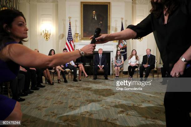US President Donald Trump holds a listening session with students survivors of mass shootings their parents and teachers in the State Dining Room at...