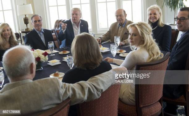 US President Donald Trump holds a lunch meeting with members of his Cabinet and their significant others at Trump National Golf Club in Potomac Falls...
