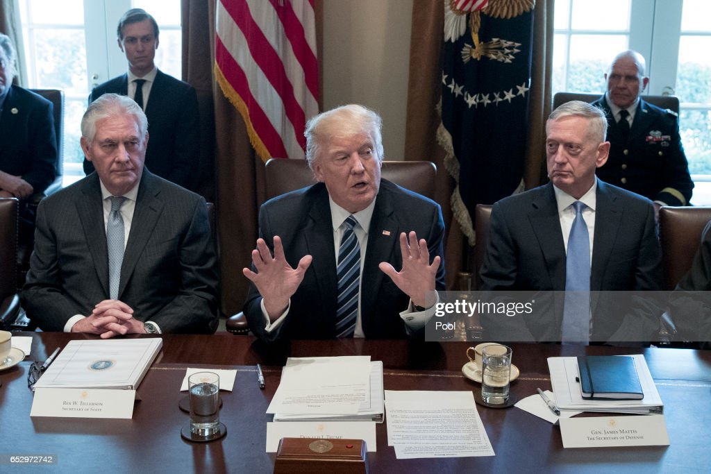 President Donald Trump holds a meeting with members of his cabinet including Secretary of State Rex Tillerson (L) and Secretary of Defense James Mattis (R) in the Cabinet Room of the White House on March 13, 2017 in Washington, DC. This was the first official meeting of Trump's cabinet.