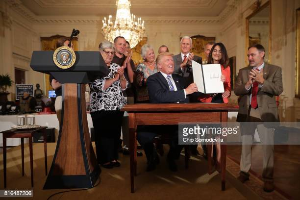 S President Donald Trump holds a proclaimation for Made in America Day and Made In America Week he signed during a product showcase in the East Room...