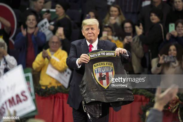US President Donald Trump holds a vest reading Bikers For Trump during a rally in Pensacola Florida US on Friday Dec 8 2017 Trump gave his most...