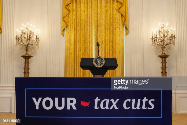 US President Donald Trump holds an event celebrating the Republican tax cut plan in the East Room of the White House in Washington DC on Friday June...