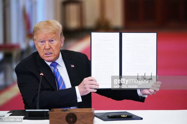 US President Donald Trump holds an executive order on 'Modernizing and Reforming the Assessment and Hiring of Federal Job Candidates' during an...