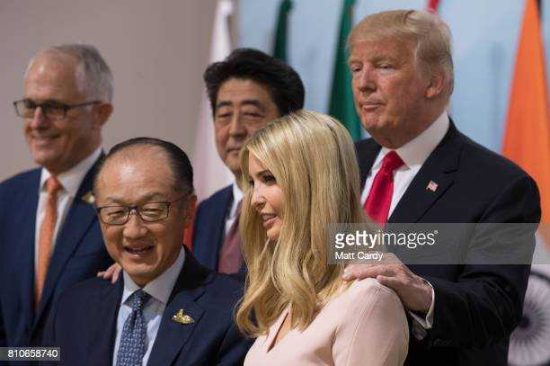 President Donald Trump holds his daughter Ivanka Trump at a panel discussion titled 'Launch Event Women's Entrepreneur Finance Initiative' on the...