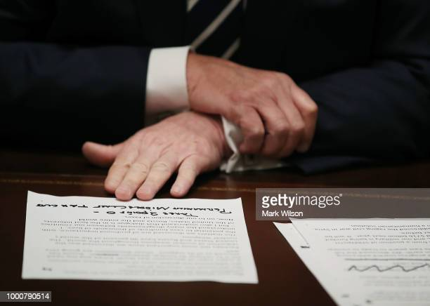S President Donald Trump holds his notes as he talks about his meeting with Russian President Vladimir Putin during a meeting with House Republicans...