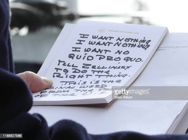 S President Donald Trump holds his notes while speaking to the media before departing from the White House on November 20 2019 in Washington DC...