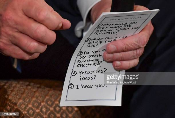 President Donald Trump holds his speaking notes during a listening session about school safety with high school students and teachers in the State...