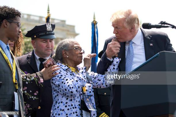 President Donald Trump holds the hand of Adrianna Valoy as he speaks about her daughter New York Police Detective Miosotis Familia who was killed in...