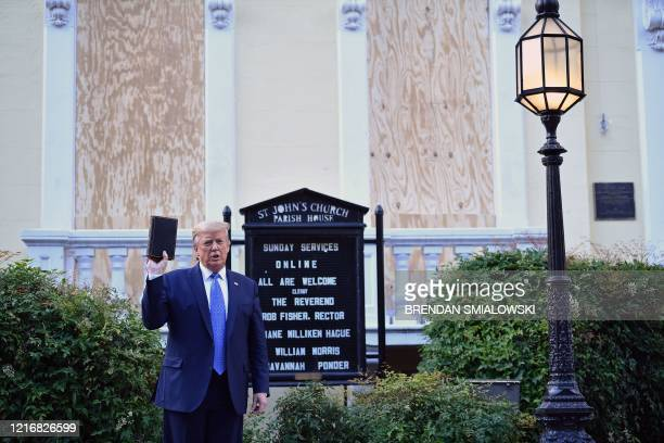 US President Donald Trump holds up a Bible outside of St John's Episcopal church across Lafayette Park in Washington DC on June 1 2020 US President...