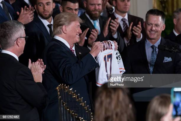 US President Donald Trump holds up a jersey he received from the Houston Astros during the celebration of the Astros' World Series Championship in...