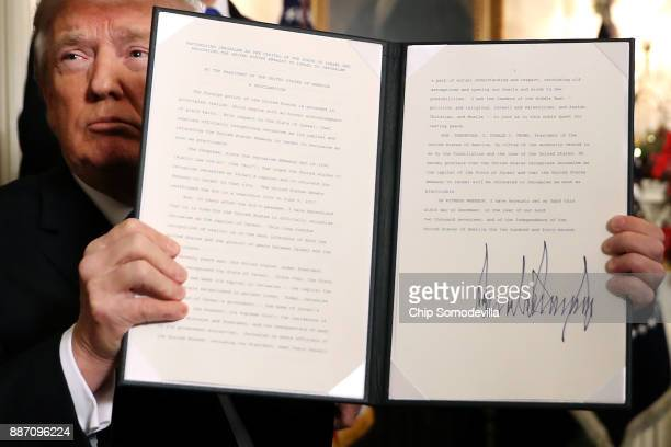 S President Donald Trump holds up a proclaimation that the US government will formally recognize Jerusalem as the capital of Israel after signing the...