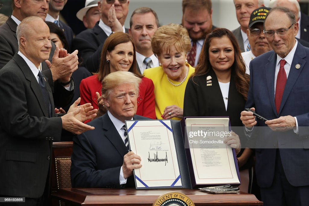 President Trump Holds Signing Ceremony For Veteran Affairs Mission Act of 2018 : News Photo