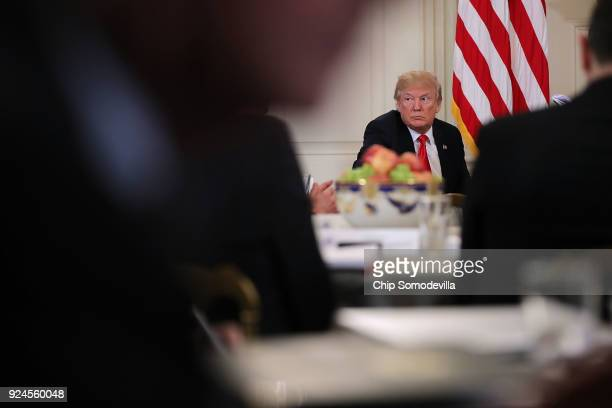 President Donald Trump hosts a business session with state governors in the State Dining Room at the White House February 26, 2018 in Washington, DC....