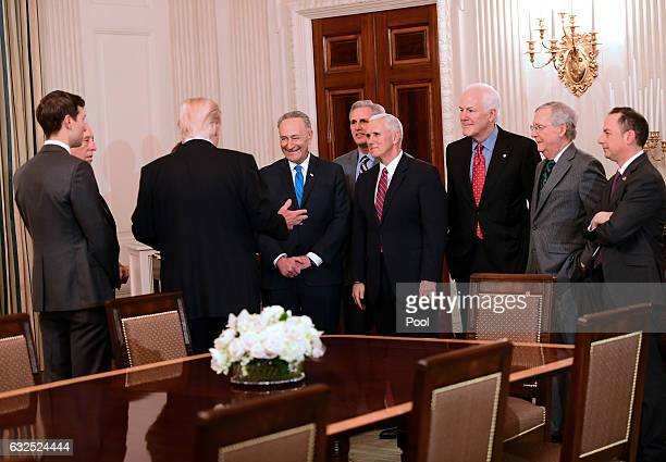 S President Donald Trump hosts a reception for House and Senate Republican and Democratic leaders in the State Dining Room of the White House January...