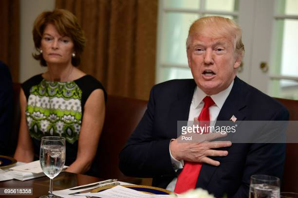President Donald Trump hosts a working lunch with members of Congress including Alaska Sen Lisa Murkowski at the White House June 13 in Washington DC...