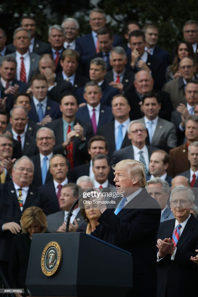 U.S. President Donald Trump hosts an event to celebrate Congress passing the Tax Cuts and Jobs Act with Republican members of the House and Senate on the South Lawn of the White House December 20, 2017 in Washington, DC. The tax bill is the first major legislative victory for the GOP-controlled Congress and Trump since he took office almost one year ago.