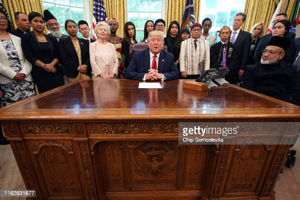 S President Donald Trump hosts survivors of religious persecution from 17 countries around the world in the Oval Office at the White House July 17...