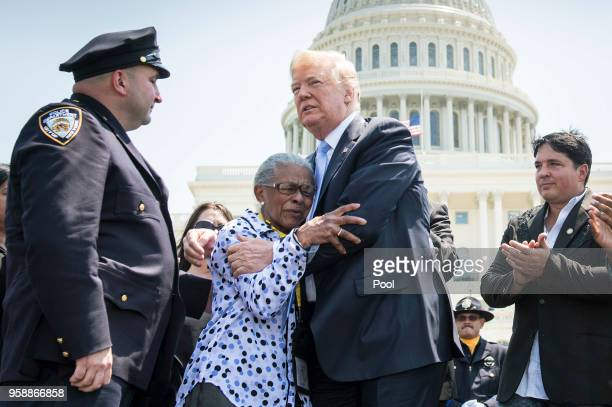 President Donald Trump hugs Adrianna Valoy whose daughter New York Police Detective Miosotis Familia was killed in the line of duty as he delivers...