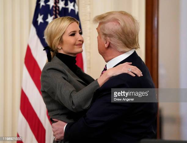 S President Donald Trump hugs his daughter and Senior Advisor Ivanka Trump after speaking in the East Room of the White House one day after the US...