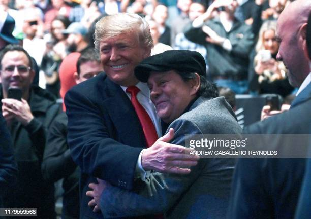 US President Donald Trump hugs Panamanian boxer Roberto Duran as he arrives to attend the Ultimate Fighting Championship at Madison Square Garden in...