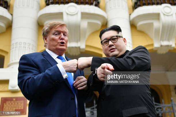President Donald Trump impersonator Russel White and North Korean leader Kim Jong Un impersonator Howard X pose together for photographs outside the...
