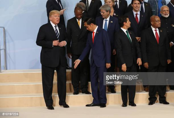 S President Donald Trump Indonesian President Joko Widodo and other leaders attend the group photo on the first day of the G20 economic summit on...