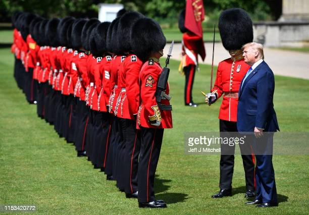 President Donald Trump inspects a Guard of Honour at Buckingham Palace on June 3 2019 in London England President Trump's threeday state visit will...