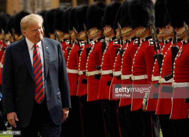 S President Donald Trump inspects a Guard of Honour formed of the Coldstream Guards at Windsor Castle on July 13 2018 in Windsor England Her Majesty...