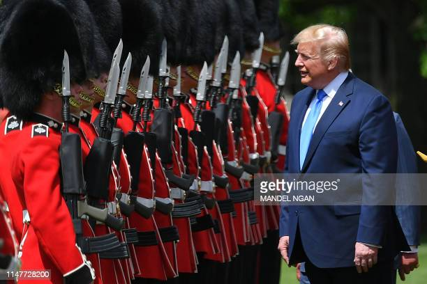 US President Donald Trump inspects an honour guard during a welcome ceremony at Buckingham Palace in central London on June 3 on the first day of...
