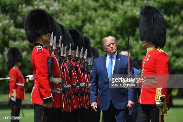 President Donald Trump inspects an honour guard during a welcome ceremony at Buckingham Palace in central London on June 3 on the first day of their...