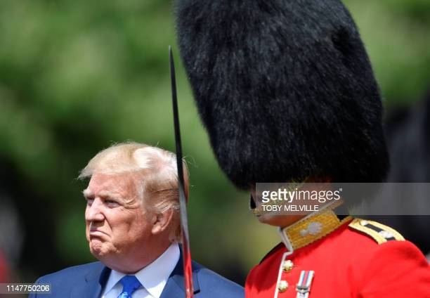 US President Donald Trump inspects the honour guard during a welcome ceremony at Buckingham Palace in central London on June 3 on the first day of...