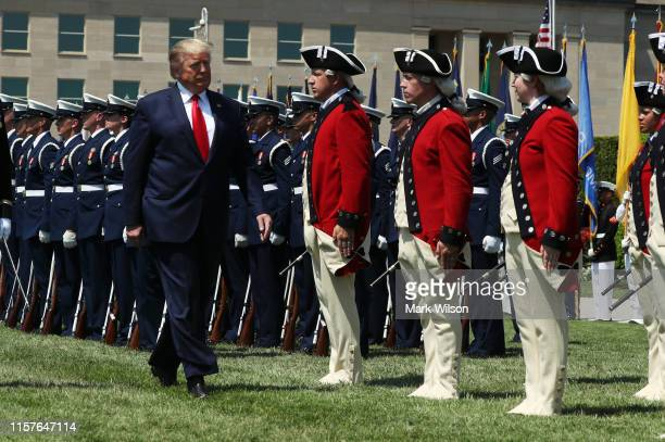 President Donald Trump inspects the troops during a full honors welcome ceremony on the parade grounds at the Pentagon, on July 25, 2019 in...