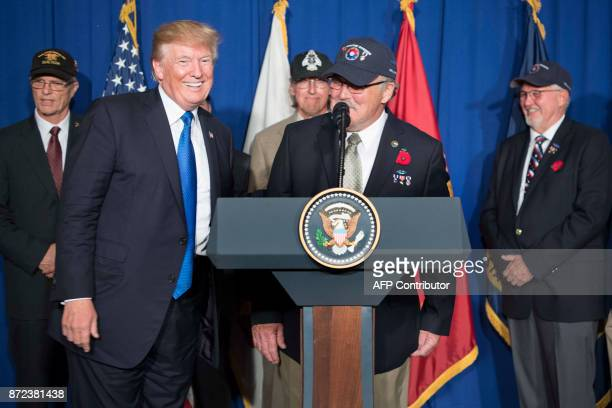 US President Donald Trump introduces Vietnam veteran Stave Hopper as he speaks before signing a proclamation in commemoration of the 50th anniversary...