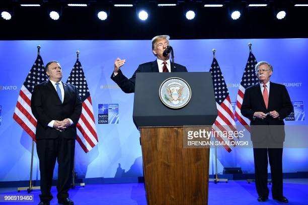 President Donald Trump is accompanied by US Secretary of State Mike Pompeo and US National Security Advisor John Bolton as he addresses a press...