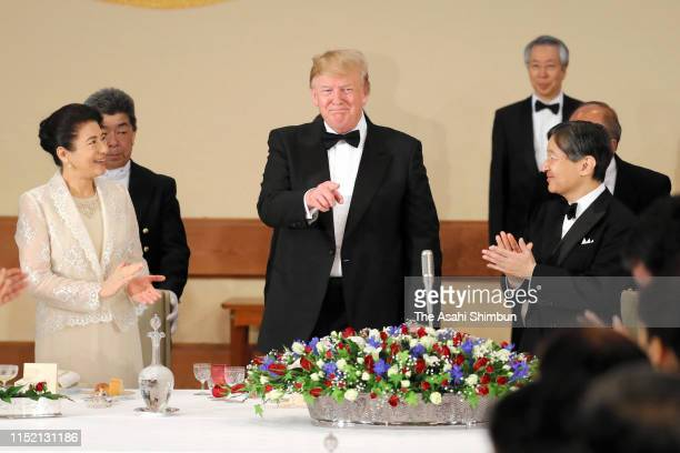 President Donald Trump is applauded after his remarks by Emperor Naruhito and Empress Masako during the state dinner at the Imperial Palace on May...