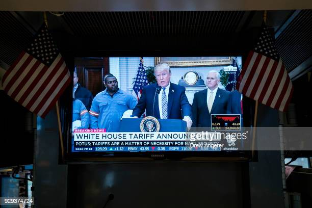 President Donald Trump is displayed on a television monitor on the floor of the New York Stock Exchange ahead of the closing bell March 8 2018 in New...