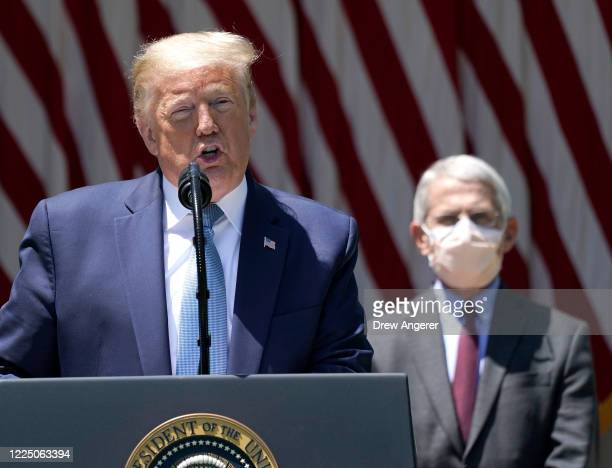 S President Donald Trump is flanked by Dr Anthony Fauci director of the National Institute of Allergy and Infectious Diseases while speaking about...