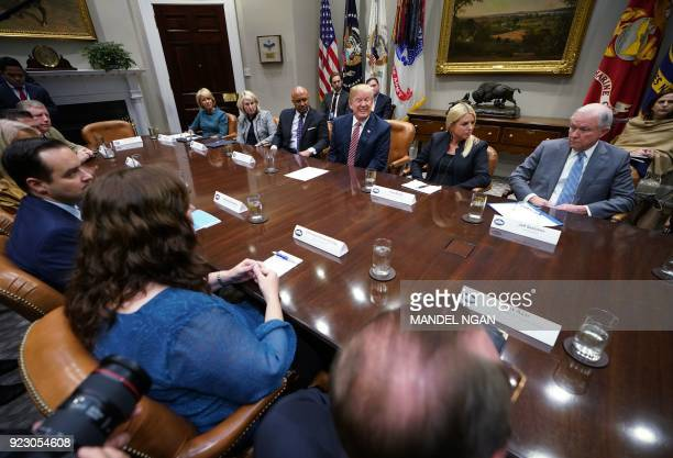 US President Donald Trump is flanked by Florida Attorney General Pam Bondi and US attorney General Jeff Sessions during a meeting with state and...