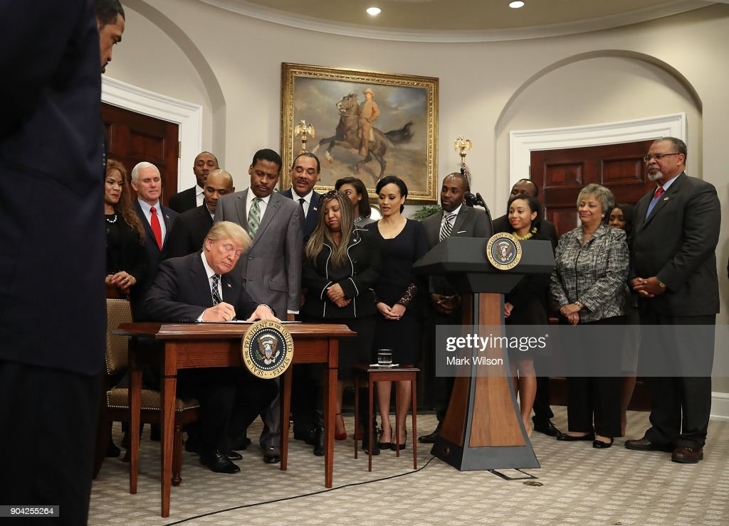 U.S. President Donald Trump is flanked by members of the African American community while signing a proclamation to honor Martin Luther King, Jr. day, in the Roosevelt Room at the White House, on January 12, 2018 in Washington, DC. Monday January 16 is a federal holiday to honor Dr. King and his legacy.