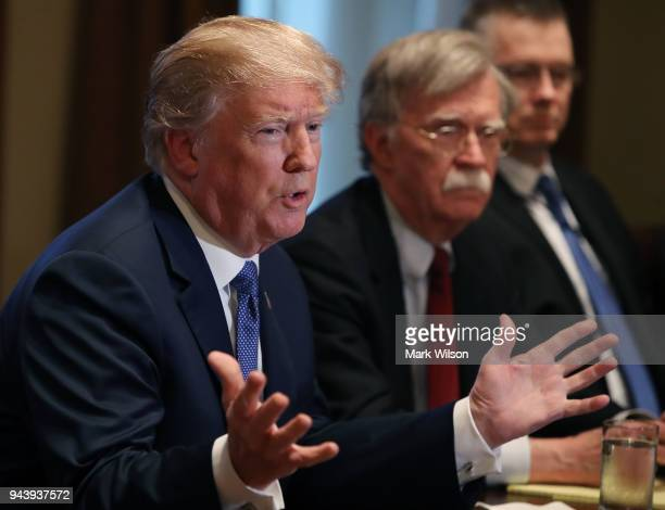 S President Donald Trump is flanked by National Security Advisor John Bolton as he speaks about the FBI raid at his lawyer Michael Cohen's office...