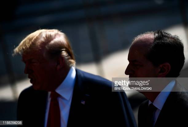 US President Donald Trump is flanked by US Labor Secretary Alexander Acosta during a media address early July 12 2019 at the White House in...