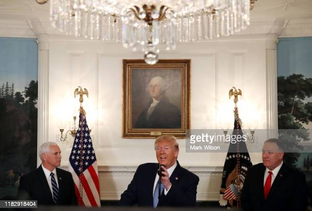 S President Donald Trump is flanked by Vice President Mike Pence and Secretary of State Mike Pompeo while making a statement in the Diplomatic Room...