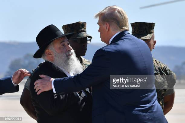 President Donald Trump is greeted by Chabad of Poway synagogue Rabbi Yisroel Goldstein upon arrival at Miramar Marine Corps Air Station in San Diego,...